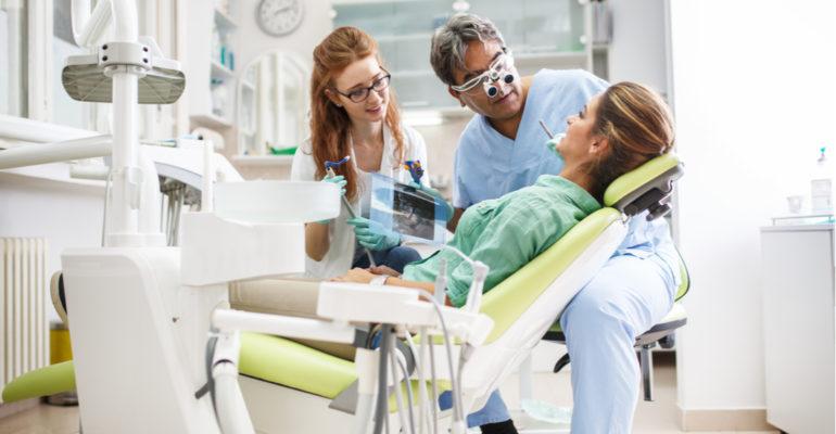 dentist giving a dental exam